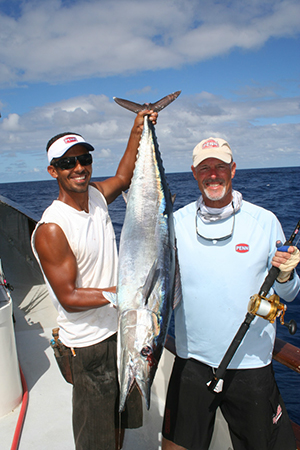 American Angler crewman Dave Ibrahim [L] and angler Jeff Ingram of Oceanside team up to show off Ingram's nice wahoo.
