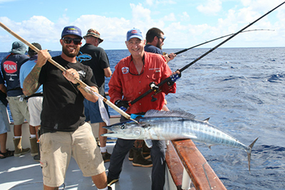 Author Steve Carson finessed this wahoo on only 20-pound line and a PENN Torque TRQ12 reel, American Angler crewman Andrew Viola hoisted it aboard.