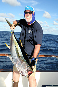 Steve Goldblatt of San Diego strains to lift his 46.2 pound yellowfin tuna caught aboard Captain Sam Patella's American Angler