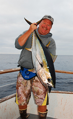 ONE HAPPY PACIFIC STAR ANGLER - Rick Francis of Cibola, AZ was a very happy angler after landing this hefty tuna on a jig aboard the sportfisher Pacific Star.